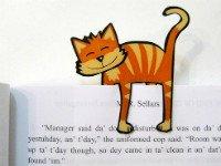 Этот котик с удовольствием укажет нужную страничку. Источник http://makeandtakes.com